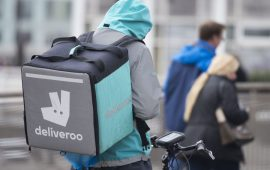 CARDIFF, UNITED KINGDOM - MAY 01: A Deliveroo food delivery rider on May 01, 2017 in Cardiff, United Kingdom. Deliveroo is calling on the government for a charter to allow gig economy platforms to provide benefits to freelancers without their employment status changing. (Photo by Matthew Horwood/Getty Images)